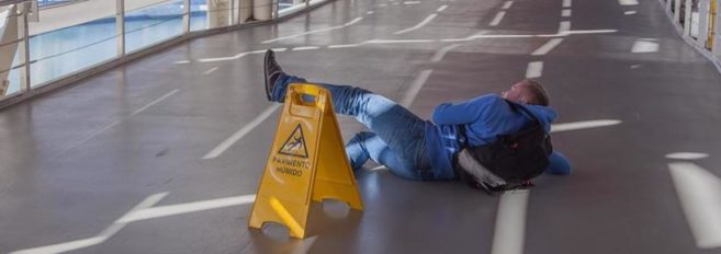 A man lying on the floor after a slip and fall accident in Pickens, SC