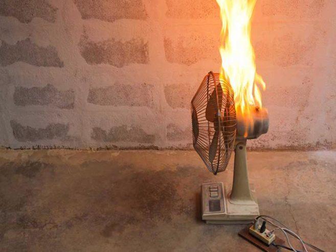 A fan on fire from faulty wiring in Greenville, SC