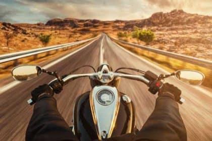 A man riding a motorcycle through the desert.